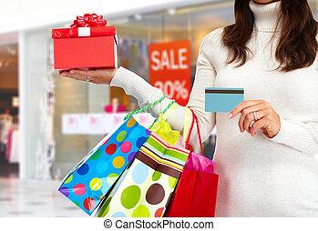 Christmas shopping woman with gift. - Christmas Shopping...