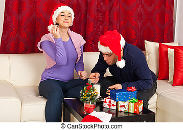 Couple enjoying Christmas night together and eating biscuits...