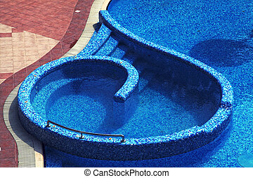 blue tiled hotel resort swimming pool - Curved steps into a...
