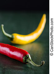 two chillis - a red and a yellow chilli