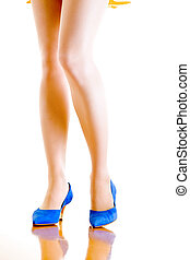 sexy woman legs in blue shoes