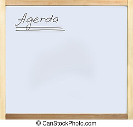 Agenda - Word agenda written on whiteboard in wooden frame