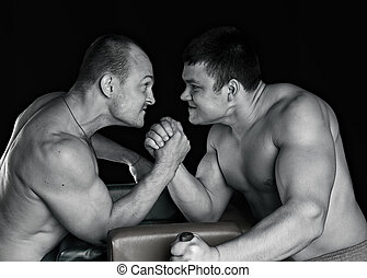 power fighting - Two strong mans armwrestling in atheletic...