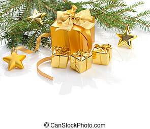 golden Christmas gifts - decorated golden gift boxes under...
