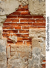 Old brick masonry with destroyed stucco