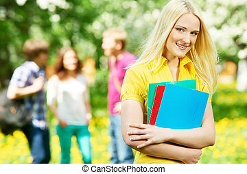 smiling student girl outdoors