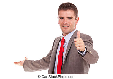 business man presents and gives thumbs up
