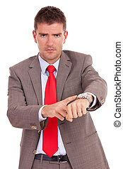 impatient business man - Angry business man pointing at his...