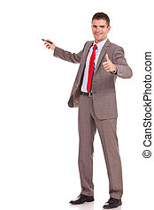 business man presenting and thumbs up - smiling young...