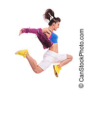 hip hop woman dancer jumping - side view of a young woman...