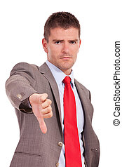 business man thumbs down - Young disappointed business man...