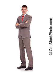 young business man with arms folded