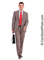 business man walking and carrying suitcase