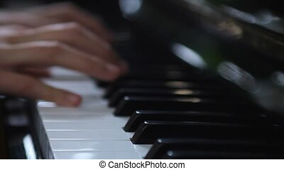 Hands playing piano - Hands of a woman playing piano