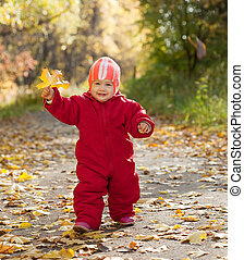 Happy toddler  in autumn park