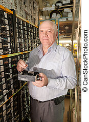 man chooses hardware in  auto  parts store