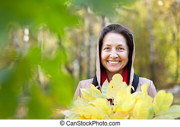 mature woman in autumn - Outdoor portrait of mature woman in...