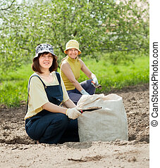 gardeners fertilizes  soil