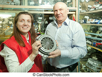 man and woman in auto parts store - mature man and woman...