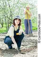 women works at  garden in spring