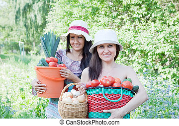 women with  harvested vegetables