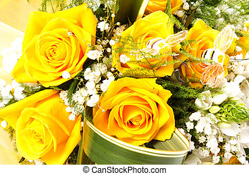 yellow rose for the san valentine day on the table with...