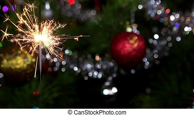Christmas tree, mirror ball and lit sparkler