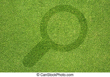 Magnifying glass icon  on green grass background