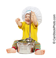 Baby cook in toque. Isolated over white