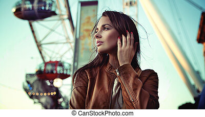 Elegant woman in lunapark