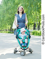 Woman walking with baby stroller