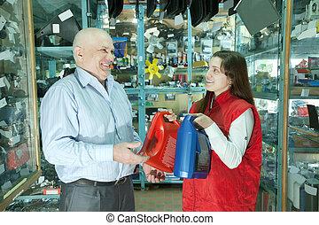 man buys motor oil