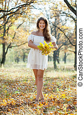 happy girl with oak posy in autumn - Outdoor portrait of...