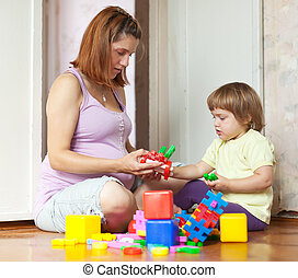 pregnant mother plays with child - pregnant mother plays...
