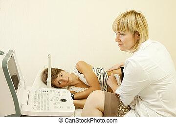 ultrasound investigation - Female doctor making ultrasound...