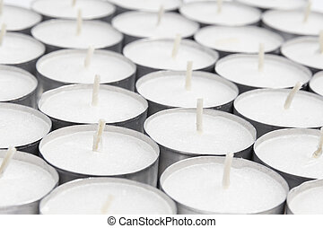array from white candles, can be used as a background