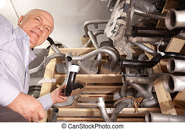 mature man in auto parts store - mature man with automotive...
