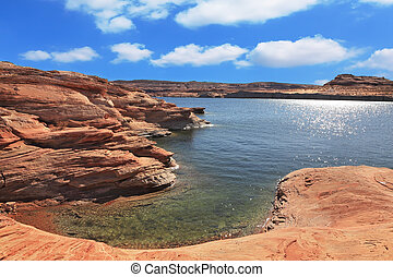 Midday heat. The artificial Lake Powell in the red desert of...