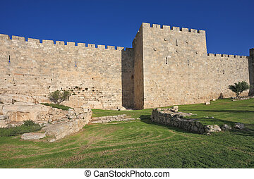 The wall of Jerusalem, lit by the bright sun