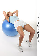 Woman on Exercise Ball - Attractive young blonde woman...