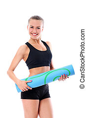 Young smiling woman holding mat for fitness