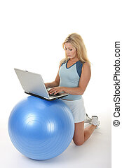 Exercise Ball Desk - Attractive young blonde woman using an...
