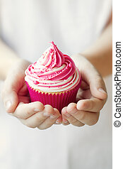 Cupcake in a child's hands