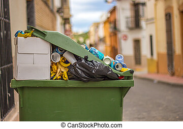 garbage in a green container