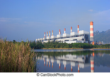 coal power plants encircled by forest and mountain