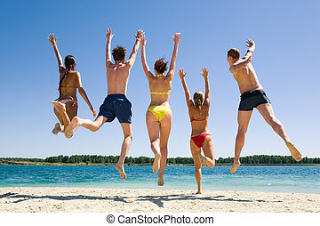 Joyful friends - Image of backs of joyful friends jumping on...