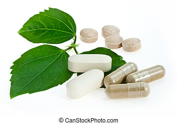 Natural pills with green leaves