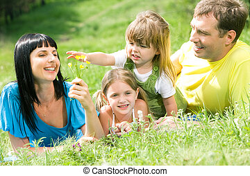 Careless summer - Portrait of family having rest on grass...