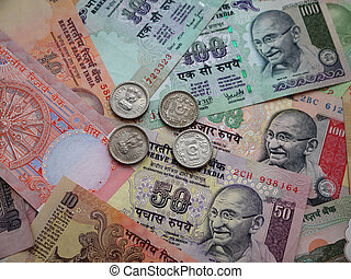 Indian money. - Photo of coins and banknotes of various...