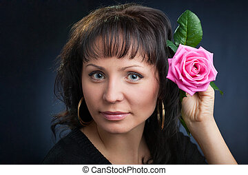 portrait of pretty young woman with rose